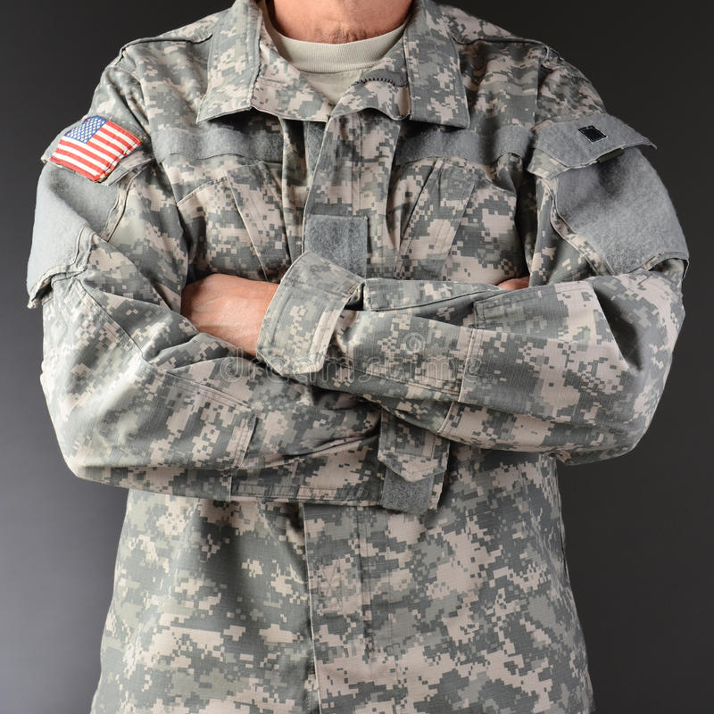 Soldier Arms Crossed. Closeup of a soldier wearing camouflage fatigues with his arms folded. Square format, man is unrecognizable stock images