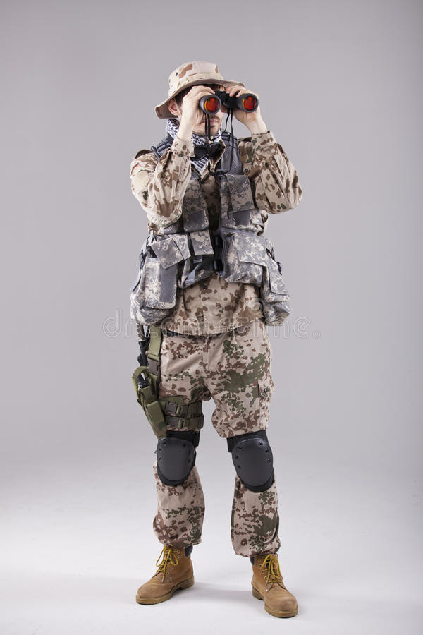 Download Soldier with binoculars stock image. Image of goggles - 25024977