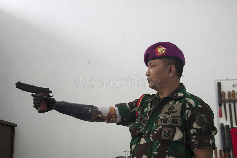 Soldier With Bionic Hand In Indonesia stock images