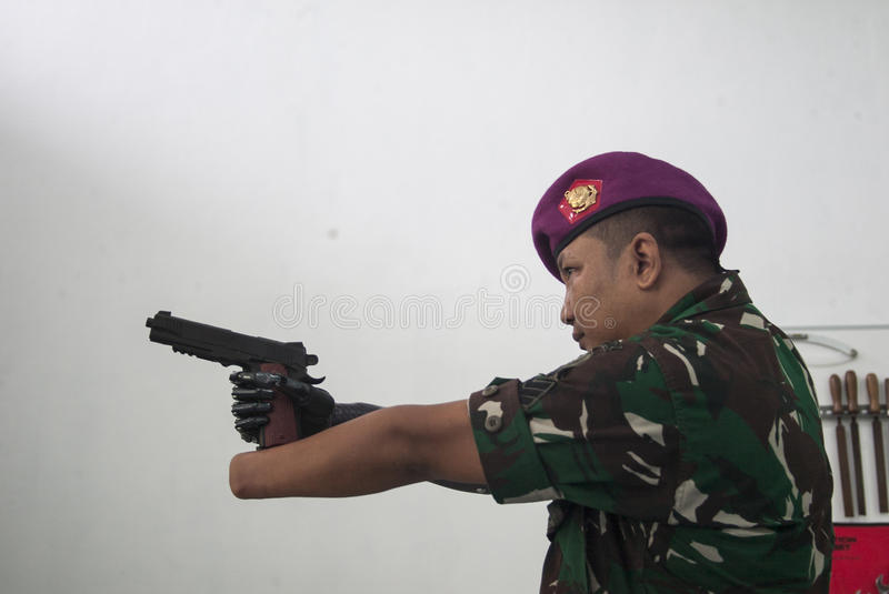 Soldier With Bionic Hand In Indonesia royalty free stock image
