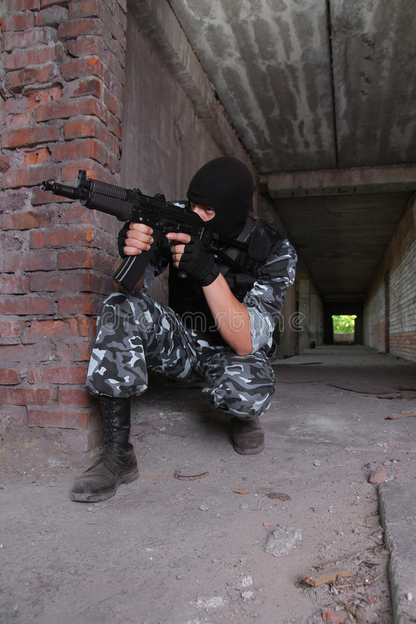 Soldier in black mask targeting with a gun royalty free stock images