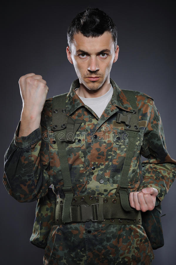 Soldier In Camouflage And Ammunition Fighting Royalty Free Stock Image