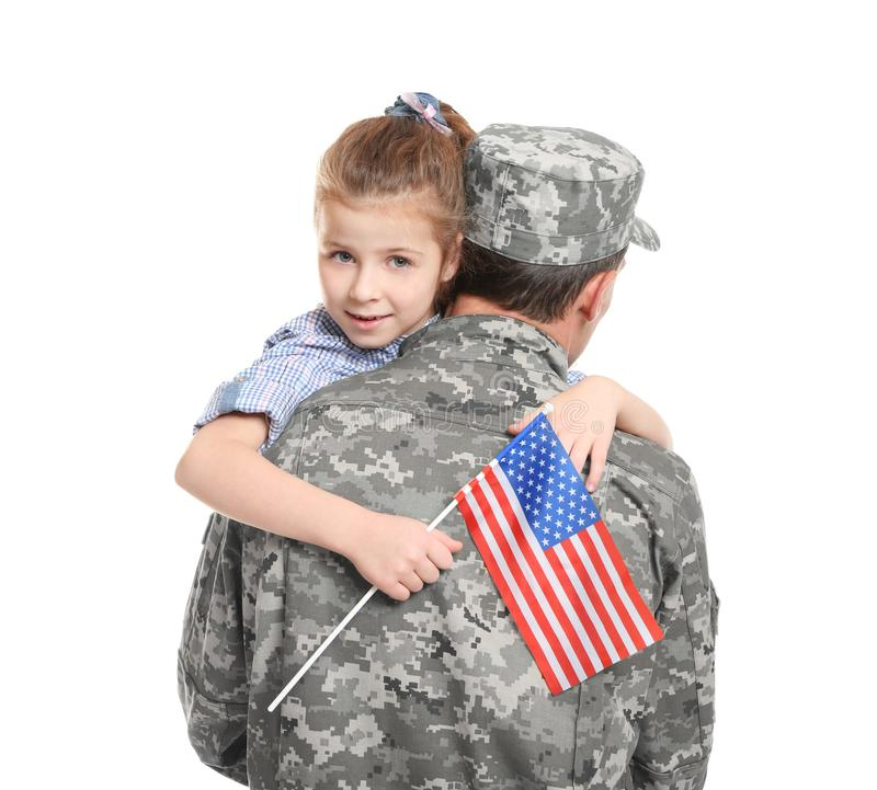 Soldier in camouflage hugging his daughter stock image