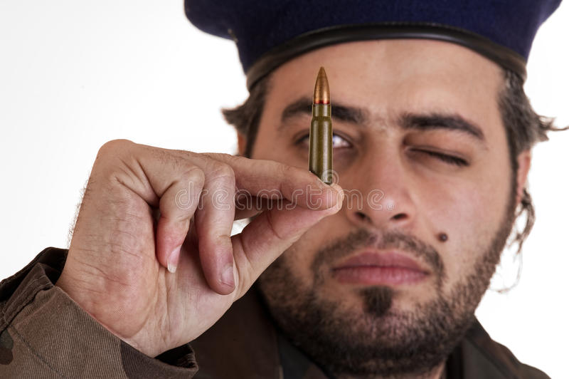 Soldier Checking His Bullet Royalty Free Stock Image