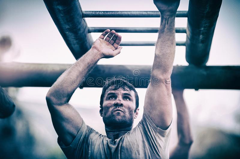 Soldier climbing monkey bars royalty free stock photography