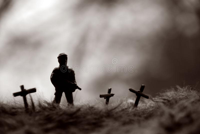 Soldier doll standing on the grave stock images