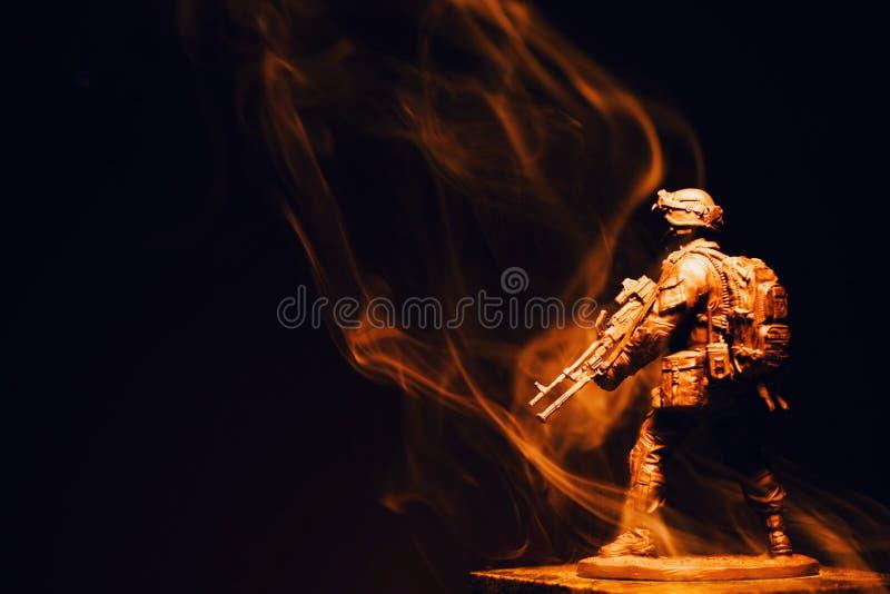 Soldier figure smoke dark background stock photos