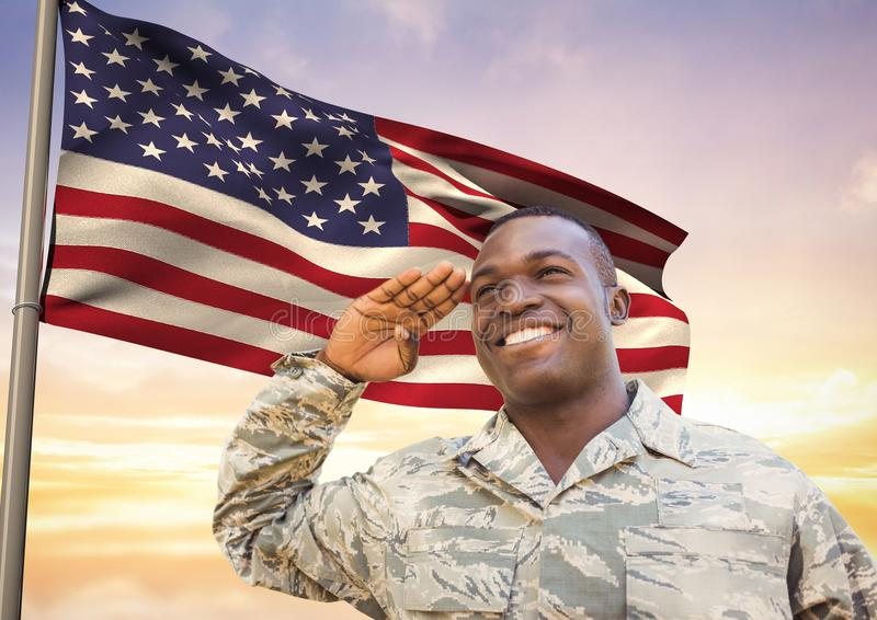 Soldier in front of usa flag saluting. Digital composite of soldier in front of usa flag saluting royalty free stock photo