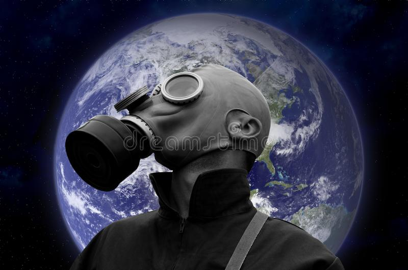 Soldier in gas mask against planet Earth stock image