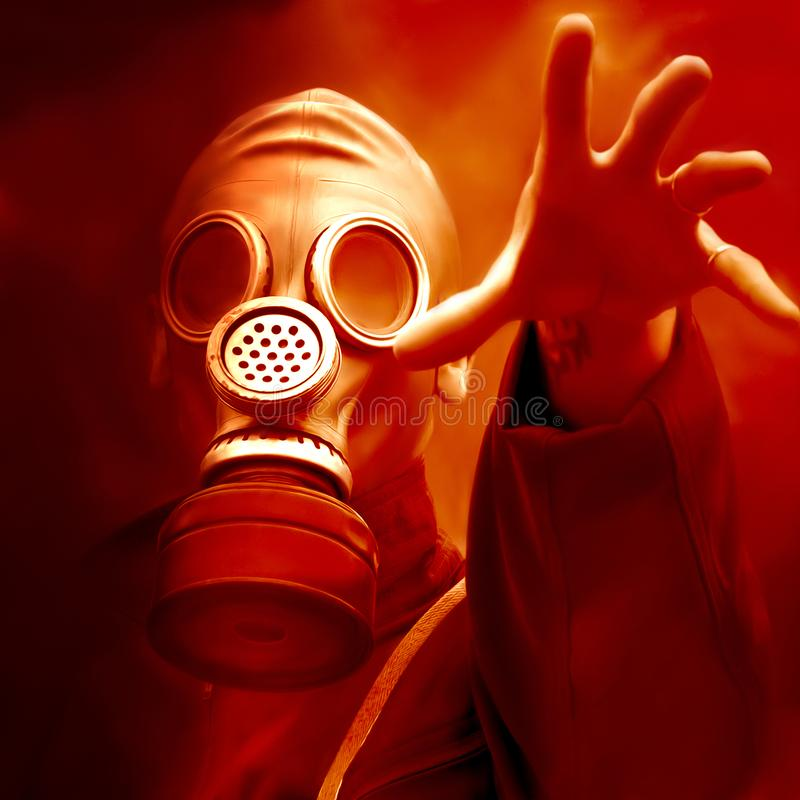 Soldier in gas mask stock photography