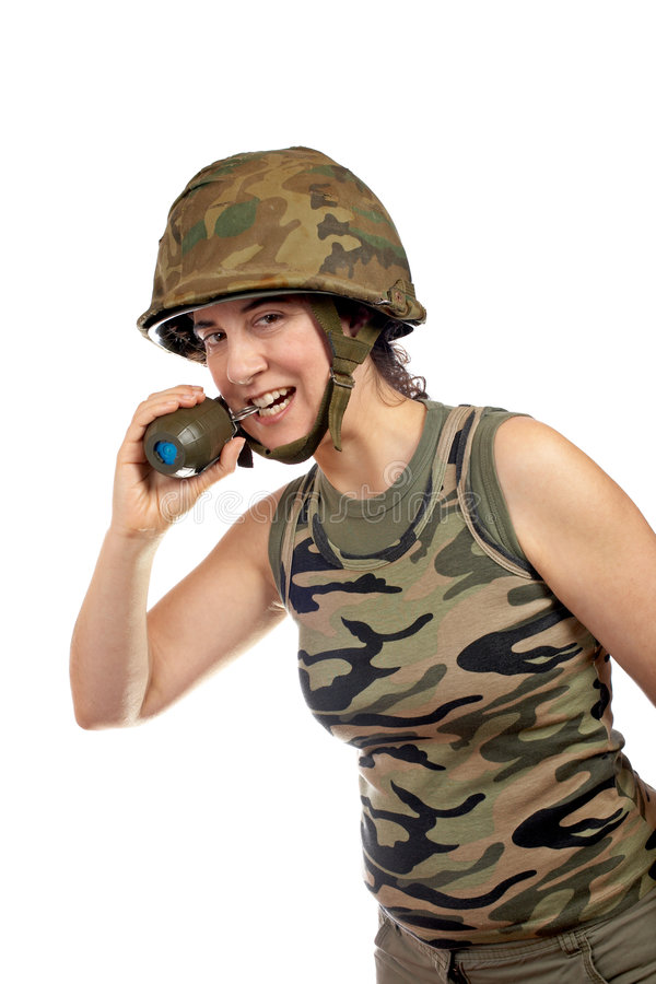 Soldier girl holding a hand grenade royalty free stock image