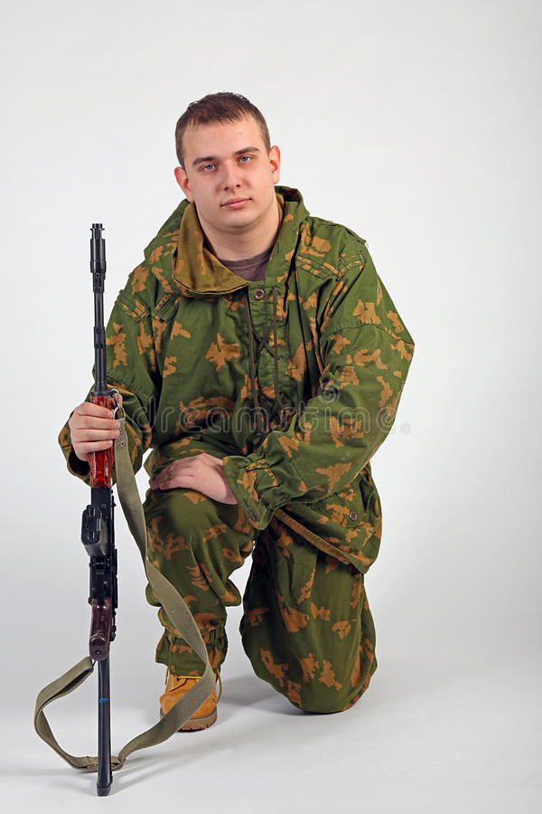 A soldier with gun - Kalashnikov stock image