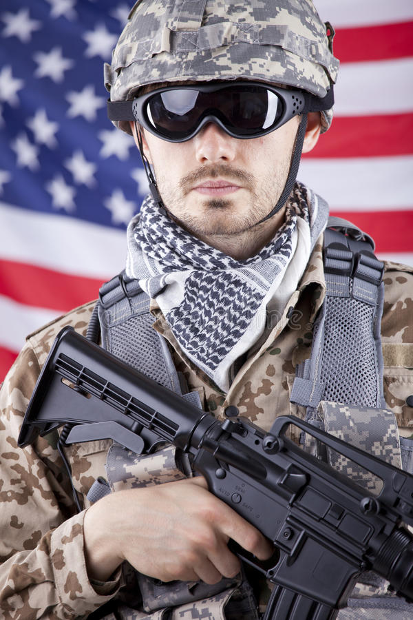 Soldier with gun over american flag royalty free stock photography