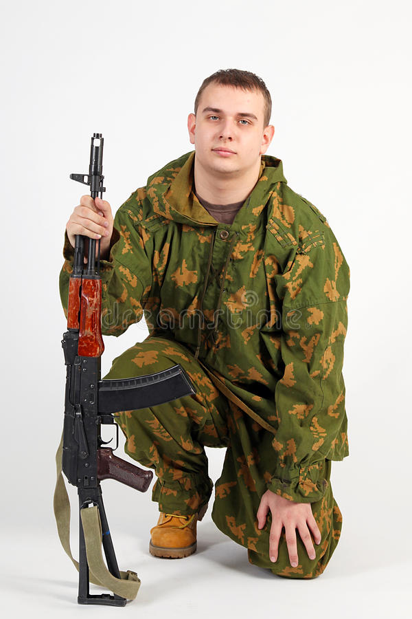 A soldier with gun. Soldier in Russian camo uniform stock photos