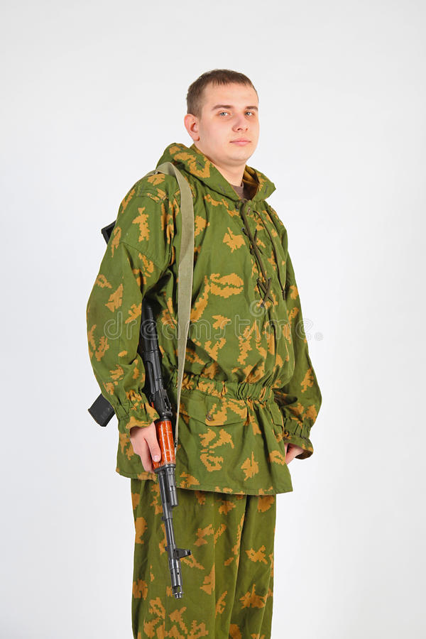 A soldier with gun. Soldier in Russian camo uniform royalty free stock image