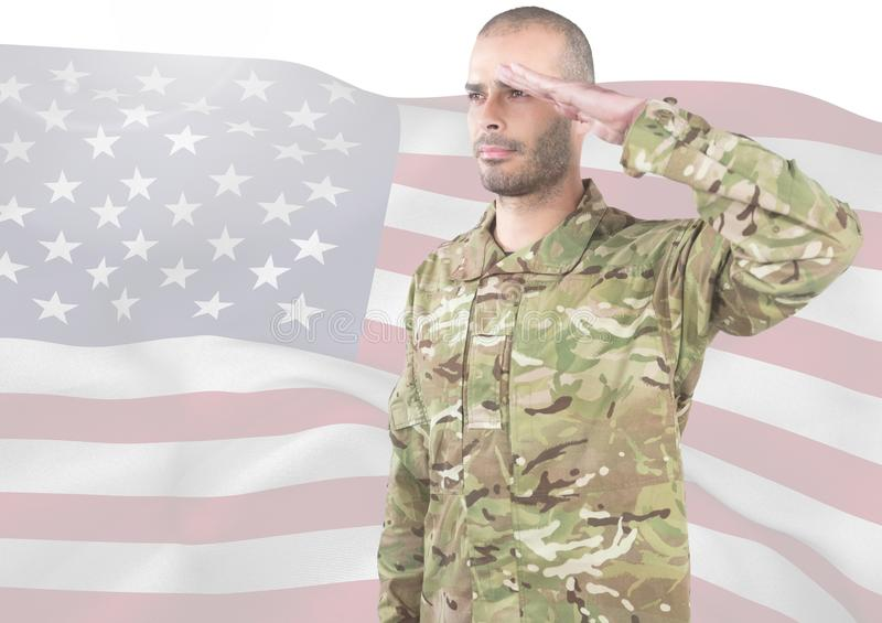 Soldier with hand on head in front of american flag stock photo