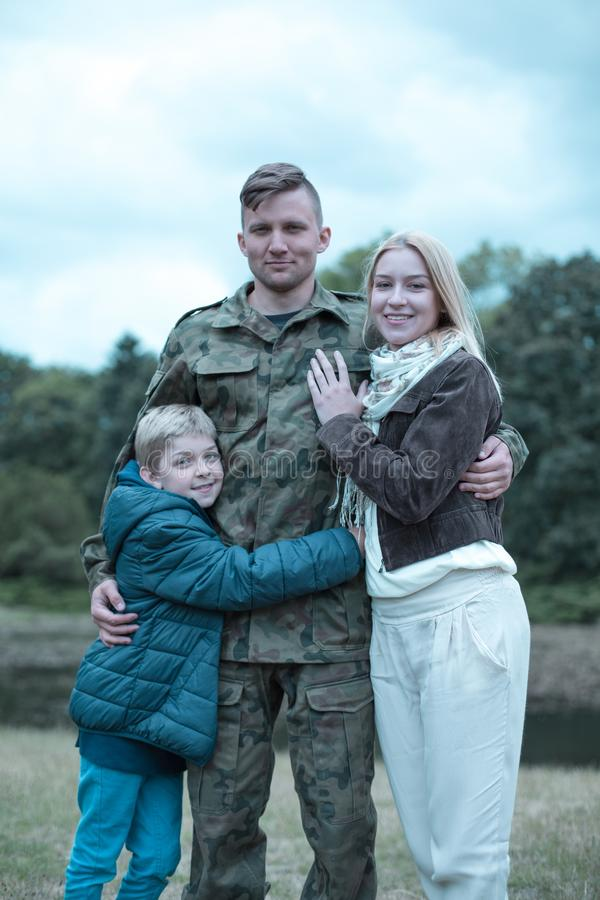 Soldier and happy family royalty free stock image