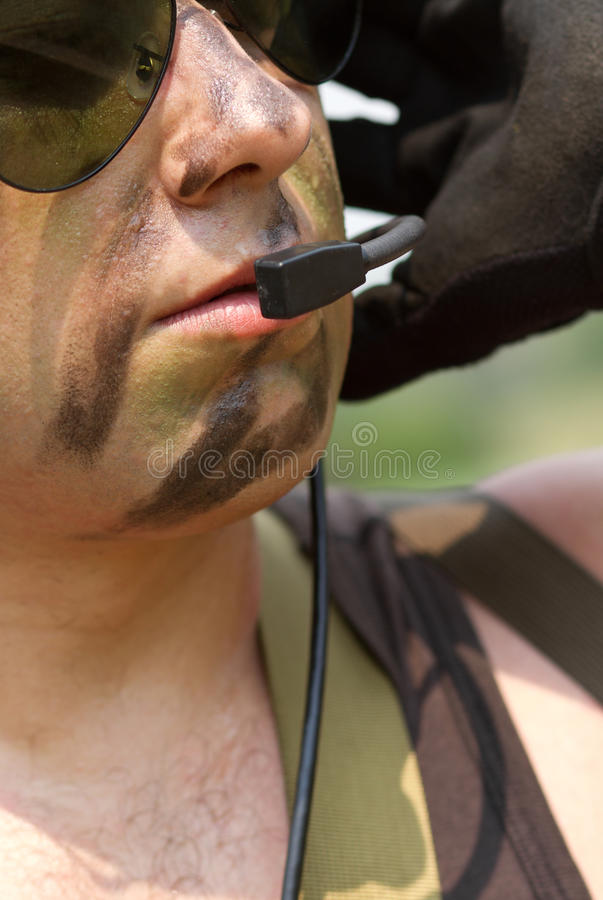 Soldier in a headset talking