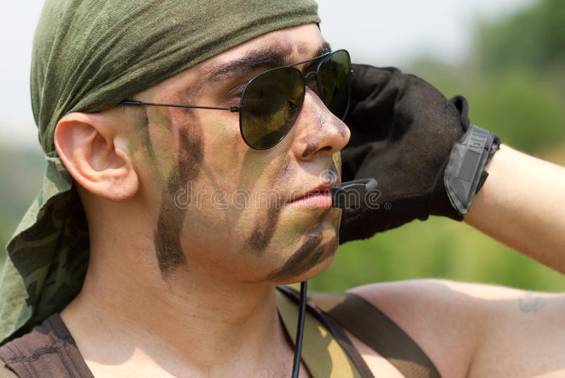Soldier in a headset talking stock photos