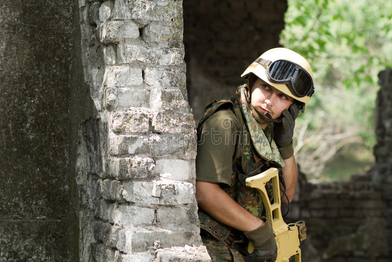 Soldier in helmet talking on a headset stock images