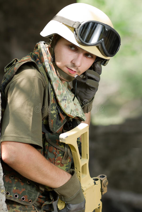 Soldier in helmet talking via headset stock images