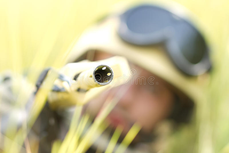 Soldier in helmet targeting with a gun stock photography
