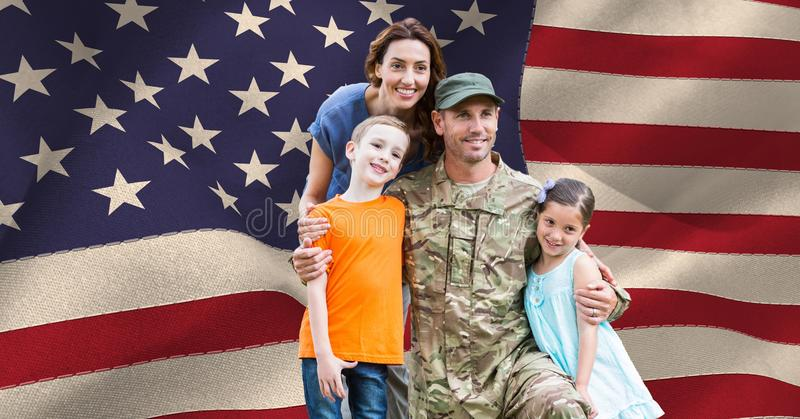 Soldier with his family in front of the US flag royalty free stock photo