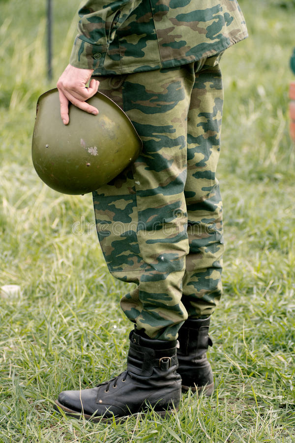 Soldier holding a helmet. End of hostilities stock photos