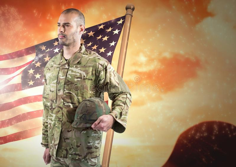 Soldier holding his helmet in front of american background royalty free stock image