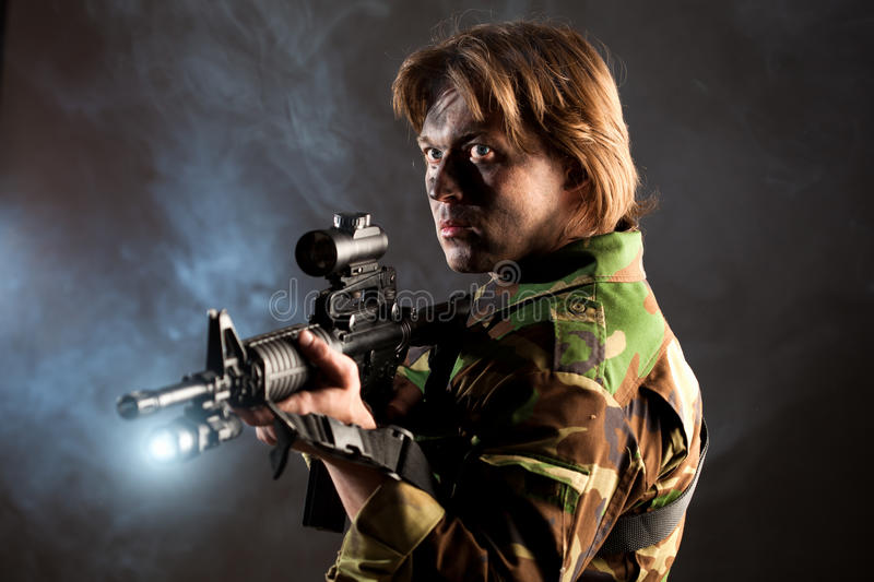 Download Soldier Holding A Weapon Royalty Free Stock Image - Image: 16597606
