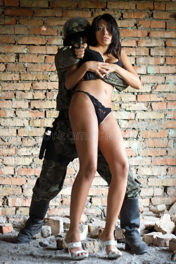 Soldier holding woman stock photos