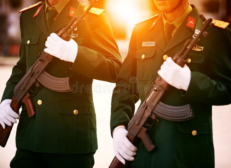 Soldier with long rifle weapon in hand stock photography