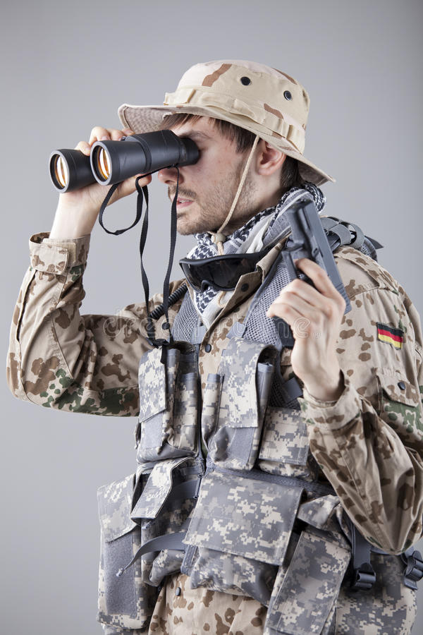 Soldier looking through binoculars royalty free stock photos