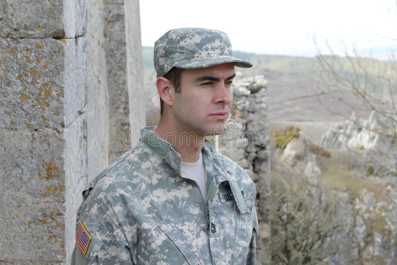 Soldier looking thoughtful and alert on an overseas mission stock photography