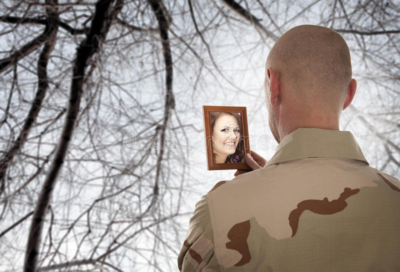 Soldier looks at the picture stock photos