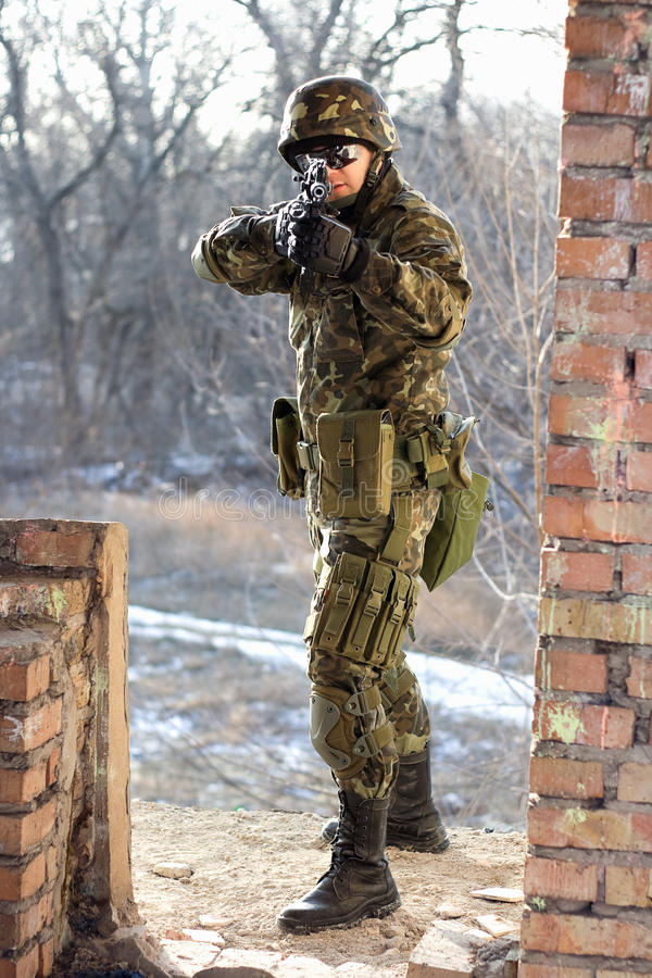 Download Soldier Near Wall With A Gun Stock Image - Image: 24000651