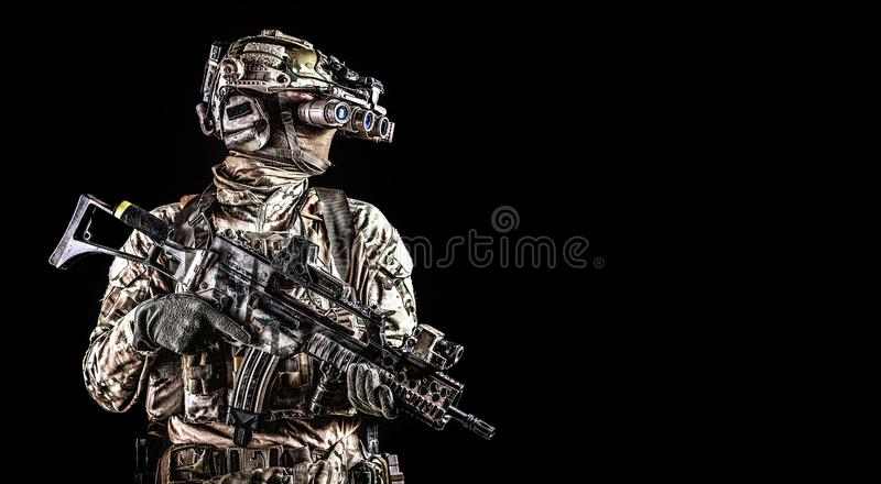 Soldier in night vision device on black background stock photo