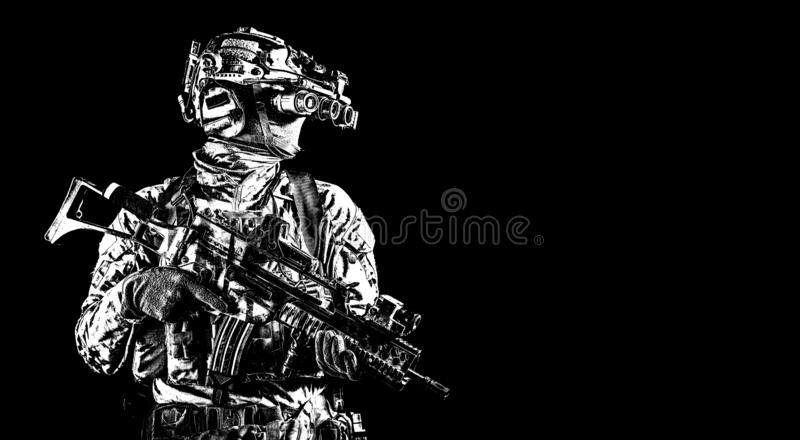 Soldier in night vision device on black background royalty free stock photos