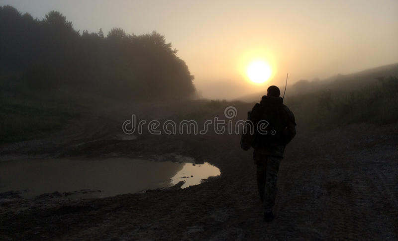 Soldier patrols into sunrise royalty free stock image