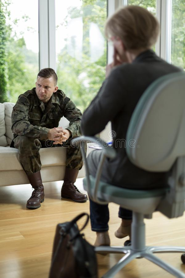 Soldier with physical trauma. At psychiatrist's office stock photos