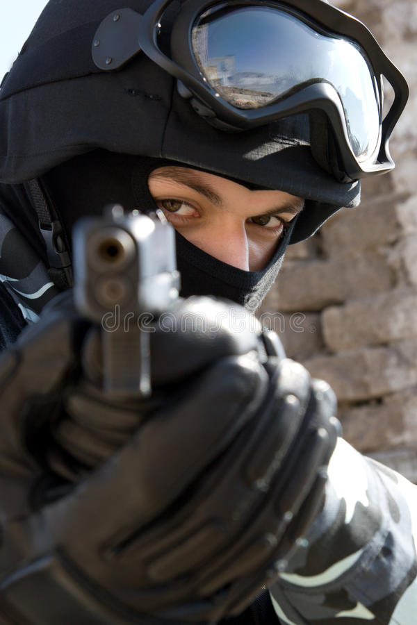 Soldier with a pistol stock images