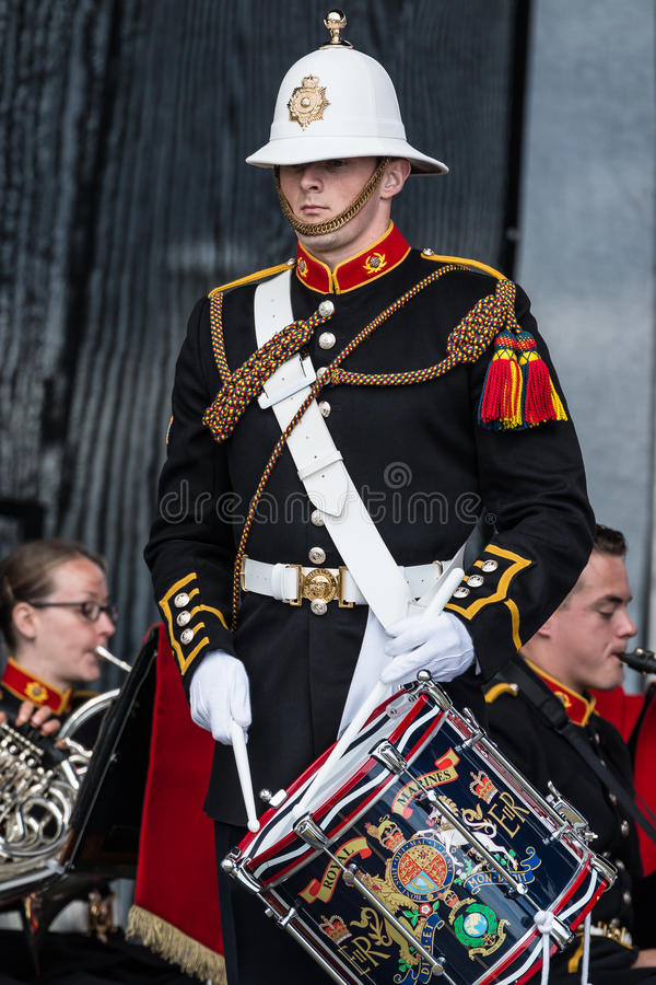 Soldier playing drum in military band, Sunderland. A soldier from the British Army in dress uniform plays the drum as part of a military band. Sunderland, United royalty free stock photo