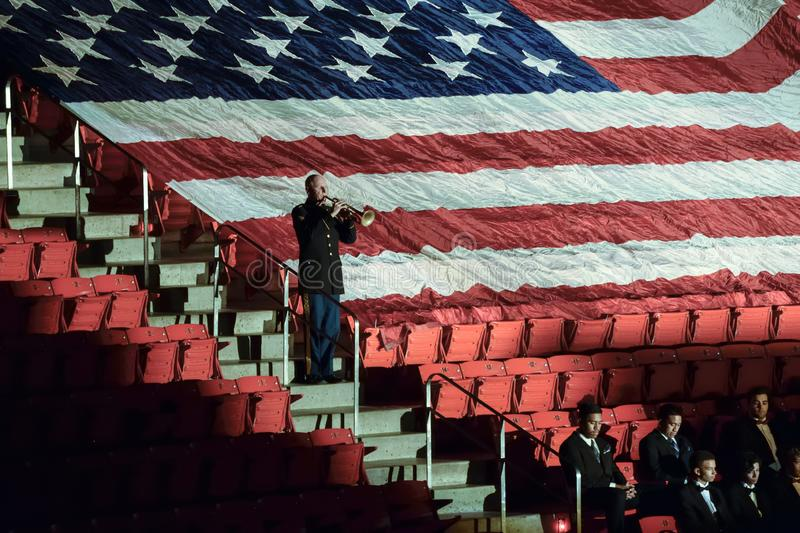Soldier plays taps at a veterans day concert royalty free stock image