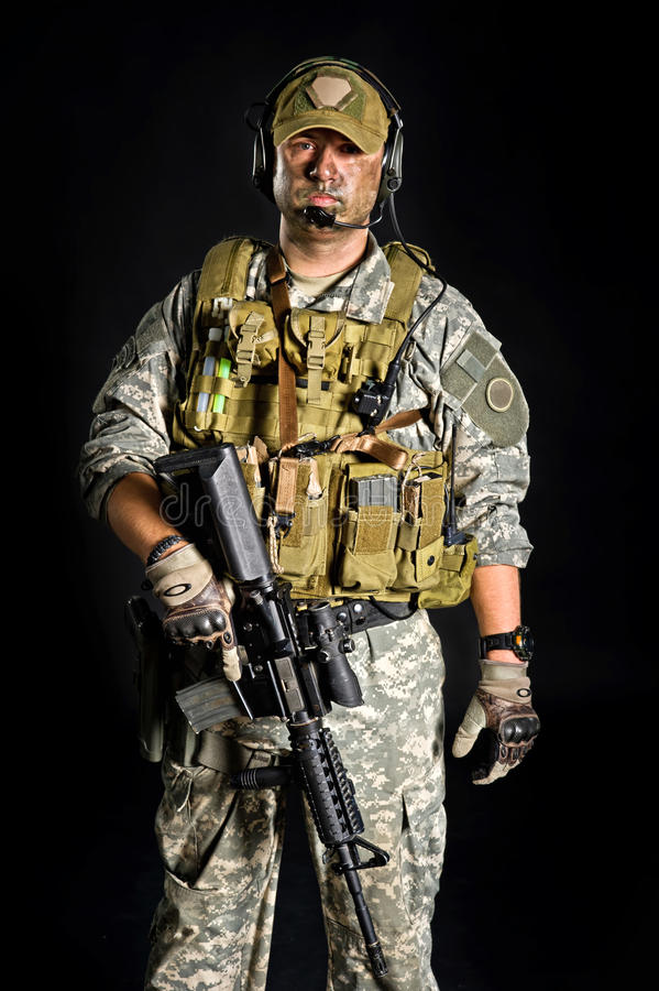 Free Soldier Posing With A Gun Royalty Free Stock Photos - 22496388