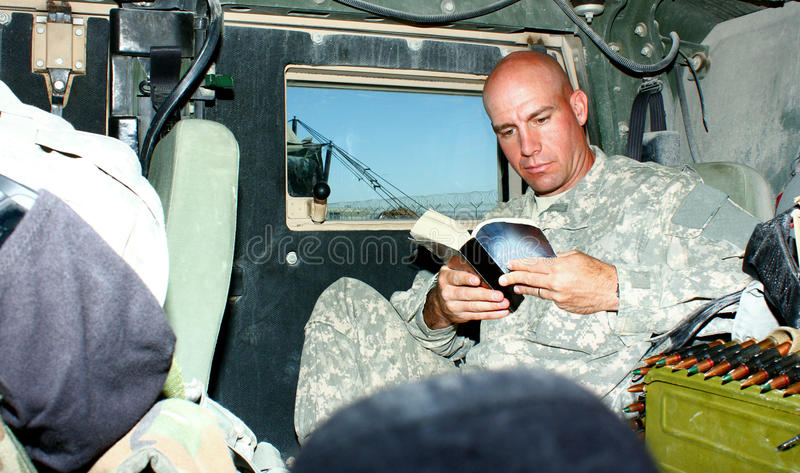 A soldier reading a book stock photography
