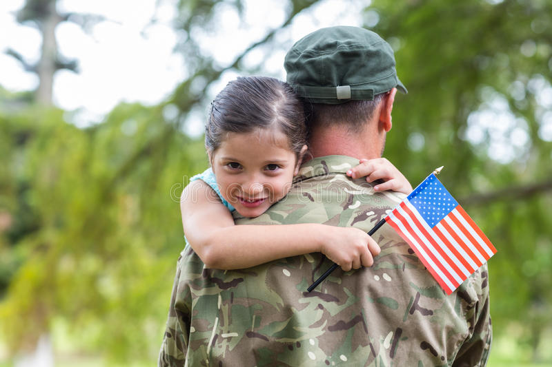 Soldier reunited with his daughter royalty free stock images