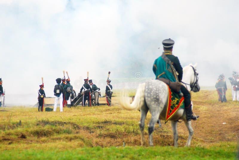 A soldier rides a white horse. stock photos