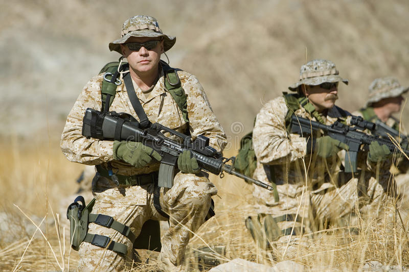 Soldier With Rifle While Team Patrolling During War stock photography