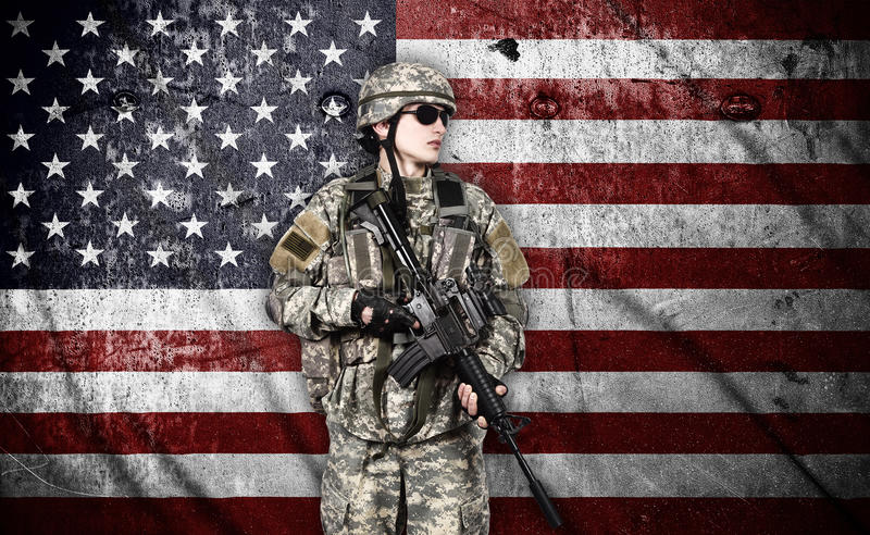 Soldier with rifle. US soldier with rifle on usa flag background royalty free stock image