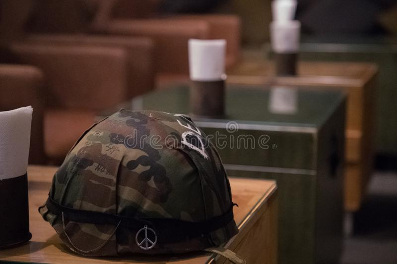 Soldier`s helmet on the table royalty free stock photos